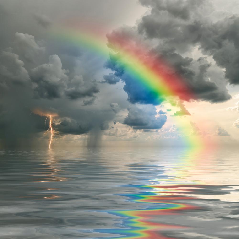 sonhar com arco-íris na água